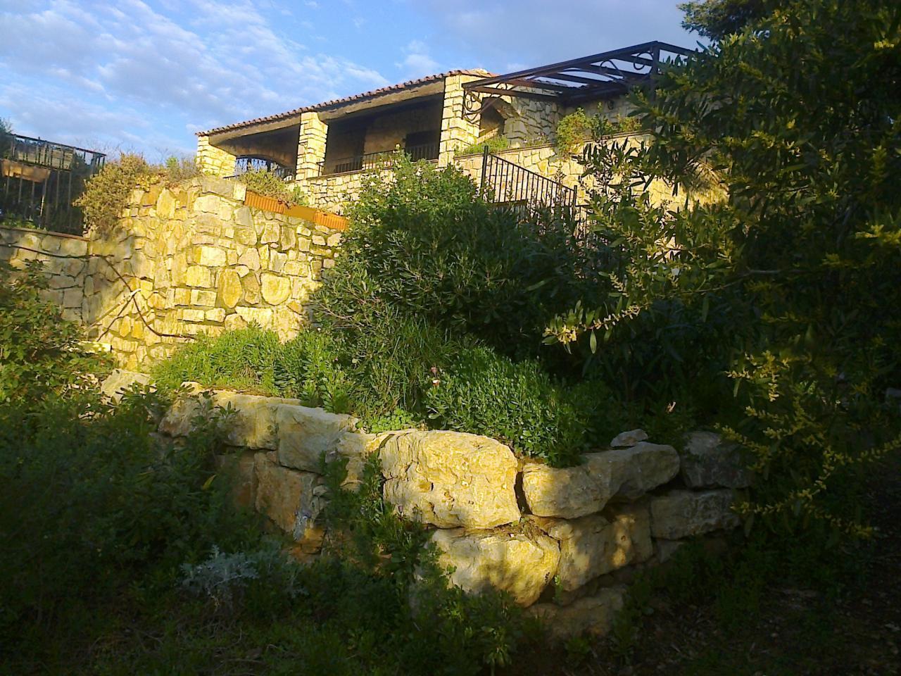 De huis-de tuin